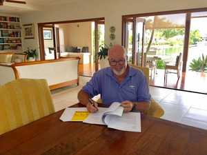THRILLING WRITER: Author Terry Quinn signs the contract for his book deal.