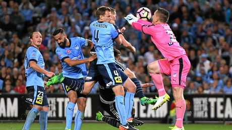 Danny Vukovic to the rescue as Besart Berisha of the Victory tries to score in extra time