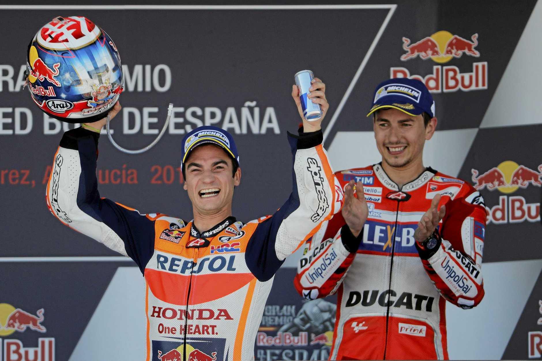 MotoGP race winner Dani Pedrosa of Spain celebrates at the Spanish Motorcycle Grand Prix.