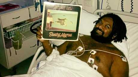 Jeremy Marou recovering in hospital after a heart attack.
