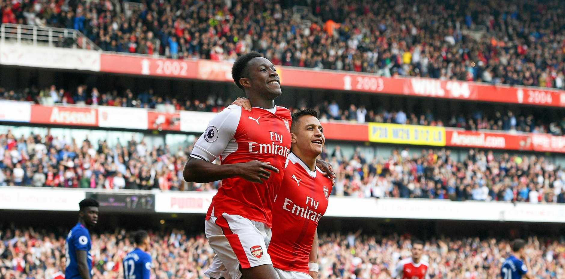 Arsenal's Danny Welbeck celebrates with his teammate Alexis Sanchez after scoring in the 2-0 win over Manchester United.