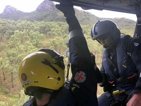 RACQ CQ Rescue air crewman Shane Bargh (right) readies a critical care paramedic before winching him down to Mt Britton.