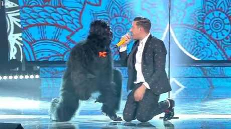 A 'gorilla' joins Italy's Eurovision contestant on stage.
