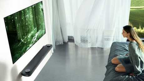 LG Signature OLED W7 TV sits flush against the wall.