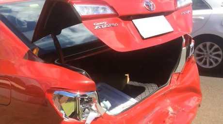 The sedan left mangled by the crash.