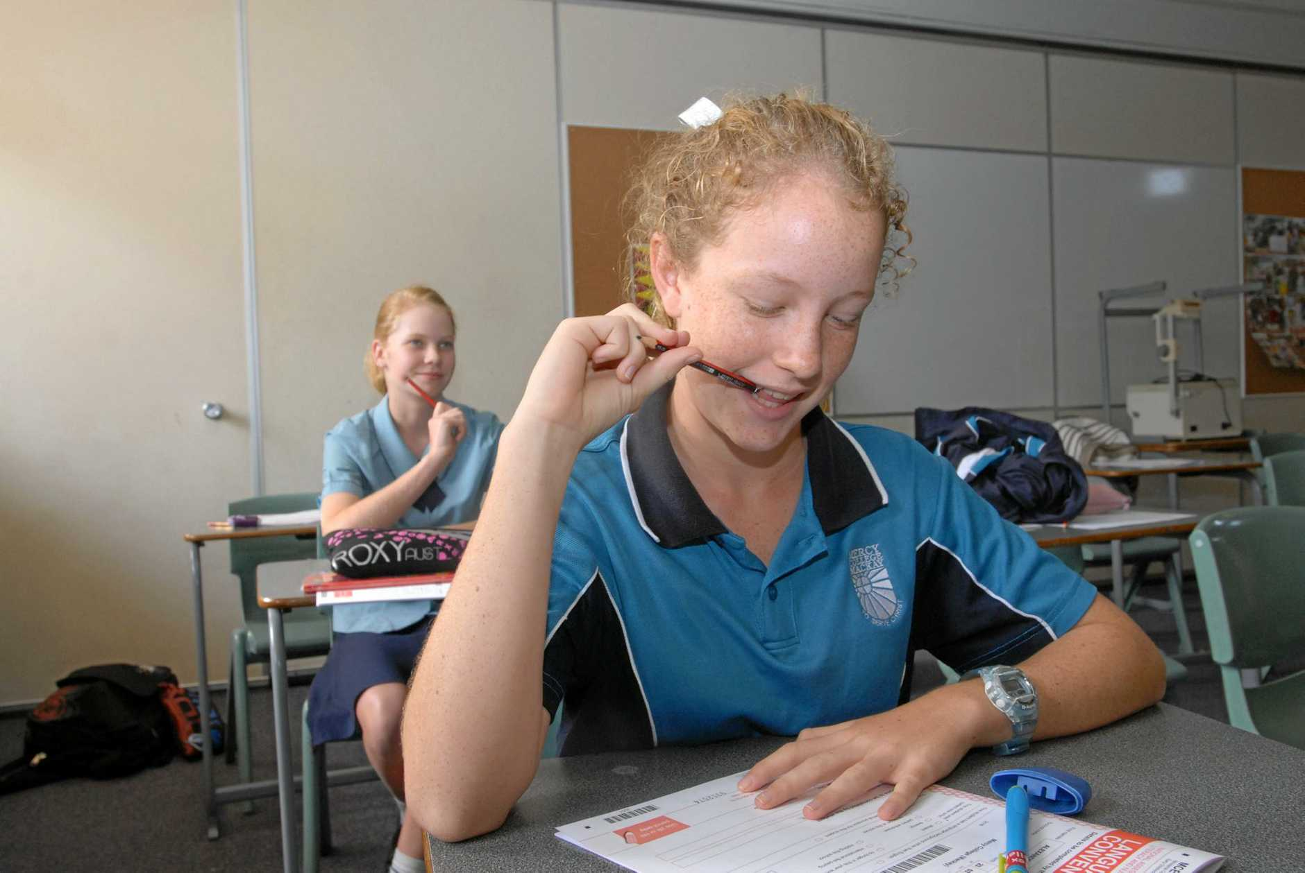 LOTS TO DO: Mercy College Year 9 Students Meg Ritchie (behind) and Sophie Webb - Smith undertaking the Naplan test.