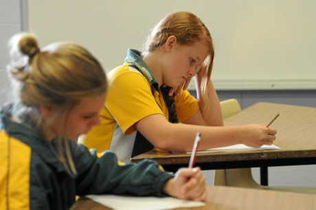 EXAMS BEGIN: Pioneer High School students Amy Hart and Kira Roberts take part in the NAPLAN test like  many students across the state.