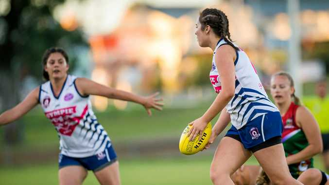 POSITIVE IN DEFEAT: They may have been defeated but the Gympie Cats are taking positives out of their losses. Emily Warhurst (pictured with the ball) looks ahead before making a pass.