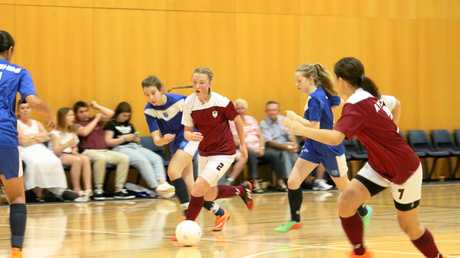 Chloe Hutton goes on the attack for Queensland Country West at the national schools futsal titles in Brisbane.