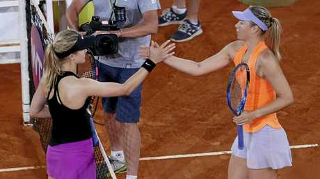 Eugenie Bouchard (left) shakes hands with Maria Sharapova after their match.