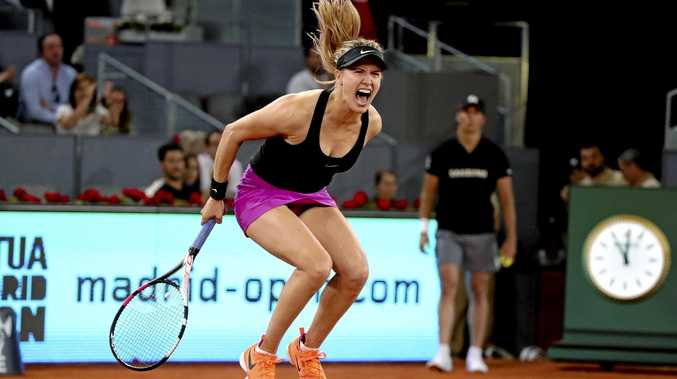 Eugenie Bouchard of Canada reacts after defeating Russian player Maria Sharapova at the Madrid Open.