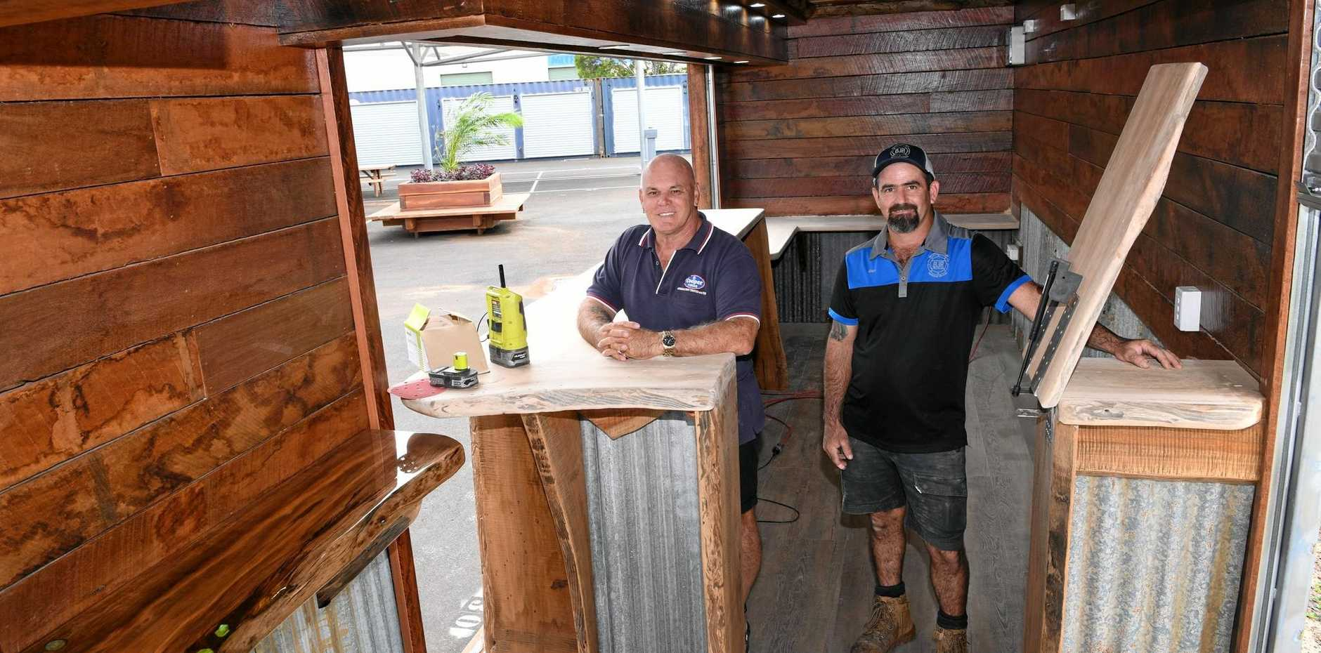 FINISHING TOUCHES: Cliff Crampton and Ben Rebbeck inside the bar at Lana's Farmers Market.
