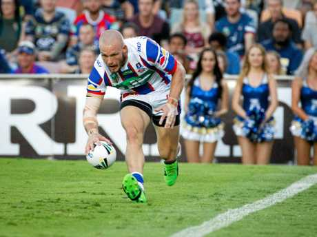 Knights winger Nathan Ross scores a try.