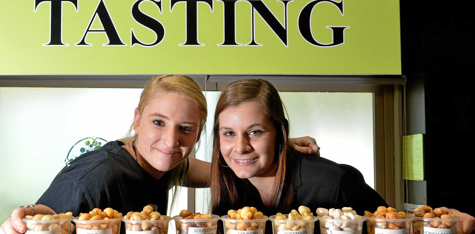 Nutworks staff members have travelled to Hong Kong for a hospitality and food industry trade show. Leah Gerbes and Nicole Keoghan pose for a photo at the business's Sunshine Coast base in 2015.