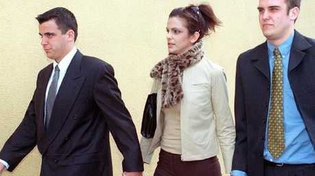 Kerry Whelan's children Matthew, Sarah and James attend their late mother's inquest at Glebe Coroner's Court in 2002.