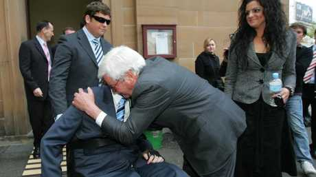 Bernie Whelan, with daughter Sarah, embraces his son Matthew in 2006 after a judge sentenced Bruce Burrell to life in prison for murdering Kerry Whelan.