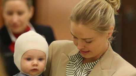 Lara Worthington and son Racer arrive at Sydney airport last week.