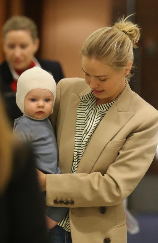 Lara Worthington and son Racer arrive at Sydney airport last week.