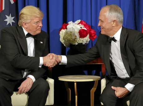 President Donald Trump and Australian Prime Minister Malcolm Turnbull shake hands during their meeting aboard the USS Intrepid, a decommissioned aircraft carrier docked in the Hudson River in New York, Thursday, May 4, 2017. (AP Photo/Pablo Martinez Monsivais)
