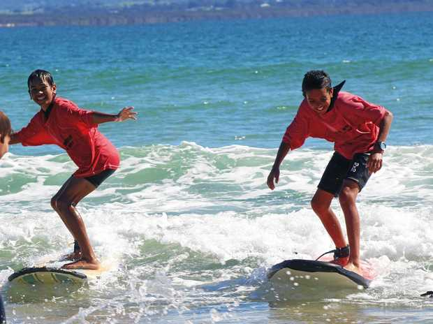 NEW SENSATIONS: The Clontarf boys enjoying the waves at Clarkes Beach.