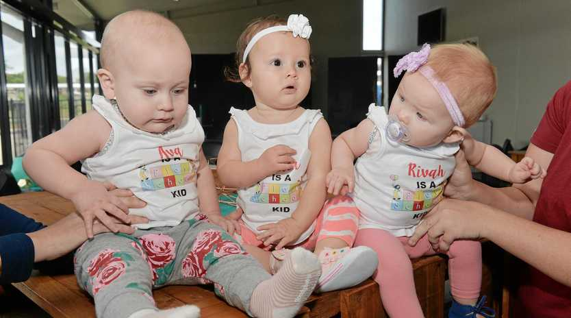 Young Play School fans Ava Flynn, Asha Williams and Rivah Cowan look forward to the start of the concert.