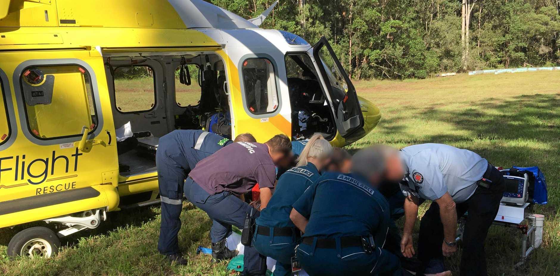 COAST CRASH: Emergency crews working on the man.
