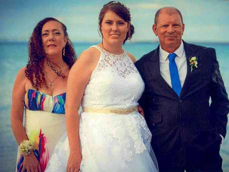 Sharon Vitala and husband Vessa with their daughter Crystal Rogers on her wedding day.