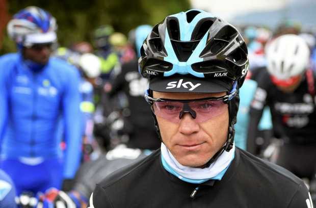 Chris Froome knocked off bike by driver during training in France