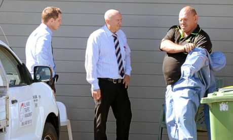 Police question Kenneth John Beattie outside a property at Raceview where a man was allegedly tied up and strangled. Beattie was later charged with torture and the attempted murder of his housemate Mal Wood.