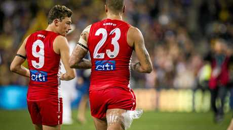 Will Hayward (left) leaves the field with boyhood hero and Sydney Swans teammate Lance Franklin at the end of play.