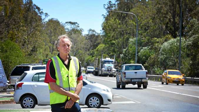 Gympie Times reporter Arthur Gorrie at the Wide Bay Hwy intersection on the Bruce Hwy.