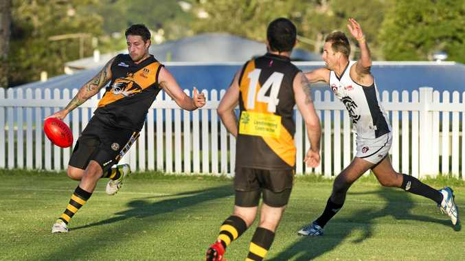 KICKING IN: George Leigh gets the Toowoomba Tigers attack moving against Coolaroo at Rockville Park earlier this season.