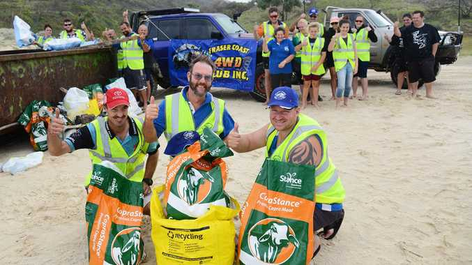 Fraser Coast 4WD Club Inc. members Daniel Peart, Kevin Pearson and Rob Selby with other members who partiipated in the Fraser Island Cleanup on Sunday.