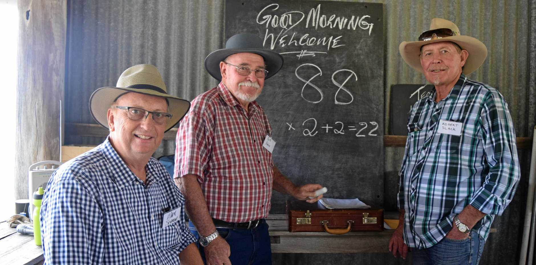 THOSE WERE THE DAYS: Meeting up at the Gooroolba reunion were former students Max Seymour and Robert Slack with Keith Evans (centre) who was teacher at Byrnestown School.