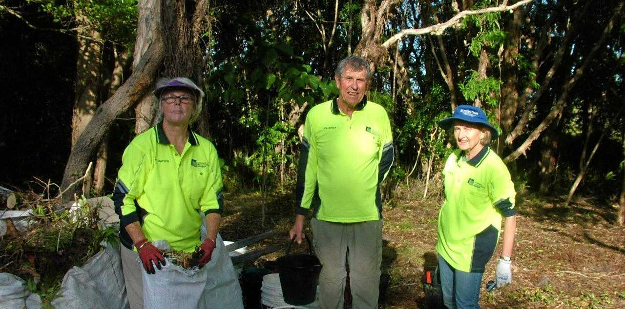 MIGHTY EFFORT: Rochelle Gooch, left, and her team weeding the entrance to Peregian Beach