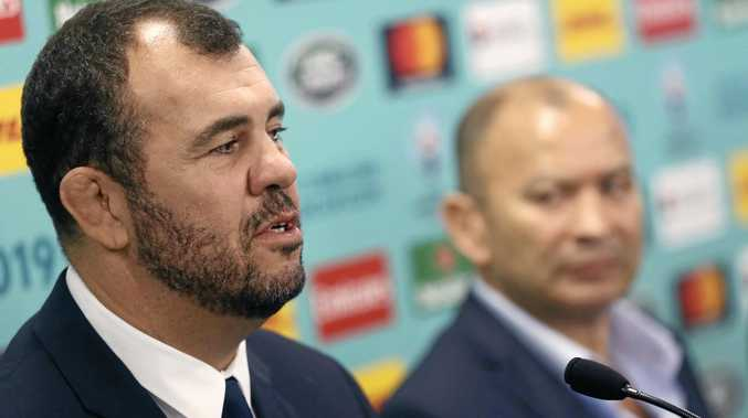 RELIEF: Wallabies coach Michael Cheika (left) and England boss Eddie Jones at the Rugby World Cup 2019 pool draw.