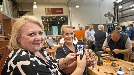 Melbourne travel agent Maria Di Pietro takes a photo for Facebook to share her Toowoomba travel experience led by Airnorth agency and corporate manager Kathy Cash (right) making handy crafts at Cobb and Co Museum, Thursday, May 11, 2017.