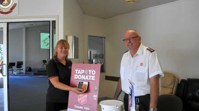 UNENDING NEED: With the Red Shield Appeal coming up fast, Julie Miller and Major Brian Smith show the latest giving technology.