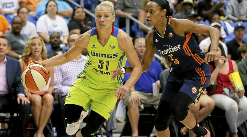 CUT: Dallas Wings guard Erin Phillips tries to beat Connecticut Suns' Jasmine Thomas