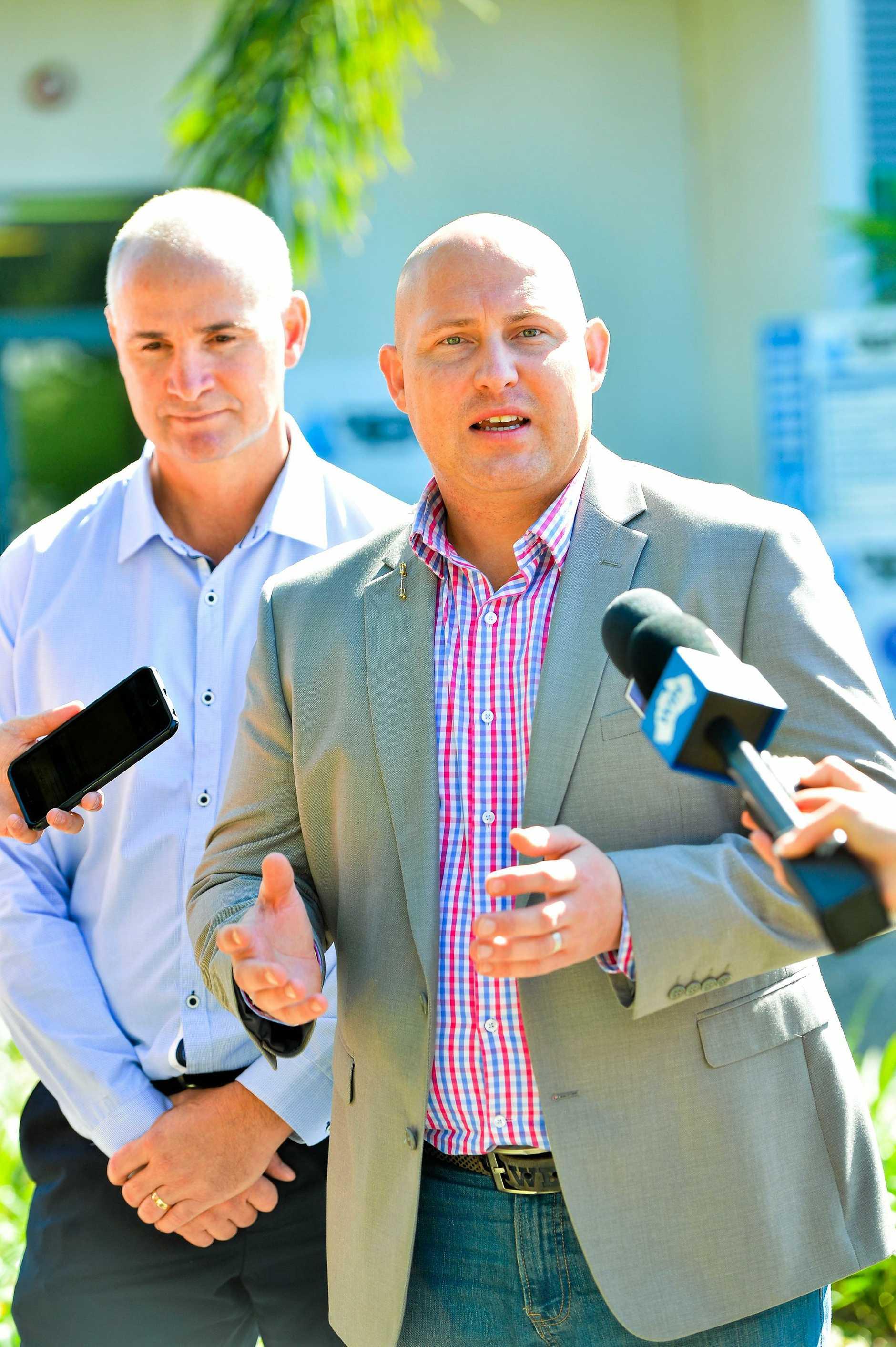 INTERVENTION: Treasurer Curtis Pitt (right) and Gladstone MP Glenn Butcher.