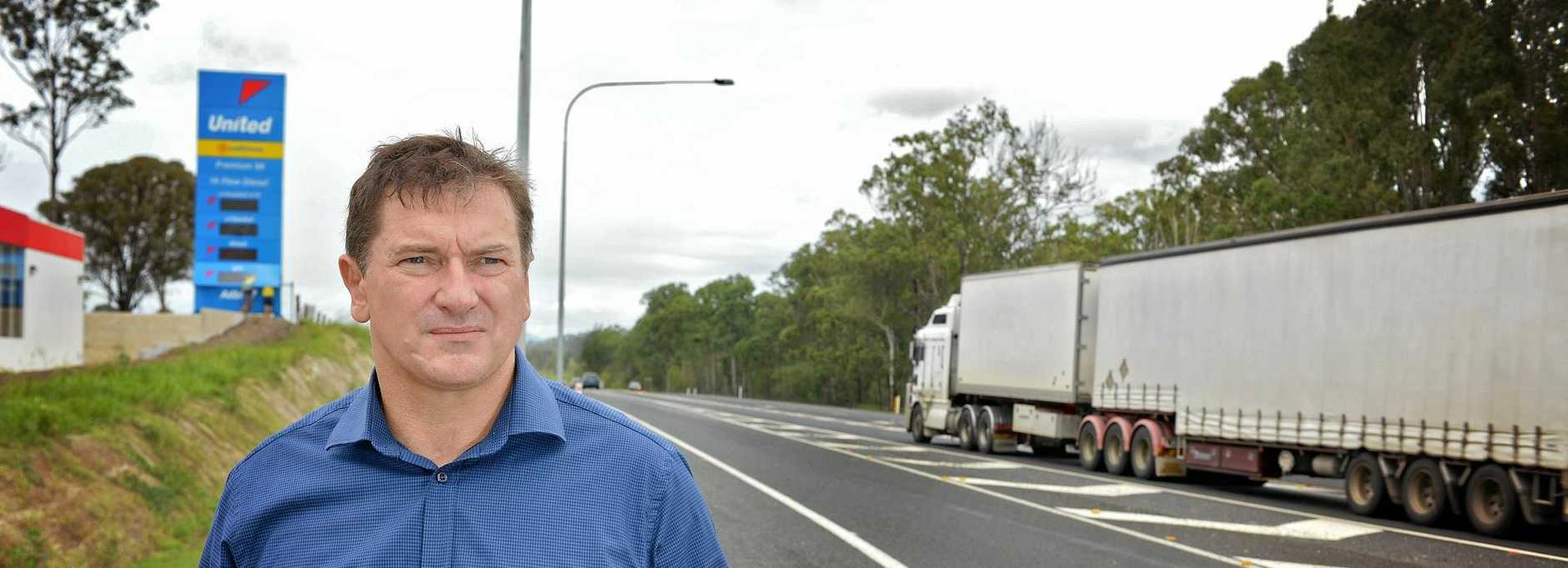 STOP THIS SLAUGHTER: Federal Wide Bay MP Llew O'Brien at the Gunalda service station near Gympie, in the middle of the highway's new death stretch.