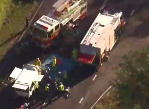 A helicopter has been tasked to airlift the woman, pinned in the crash wreckage, to hospital.