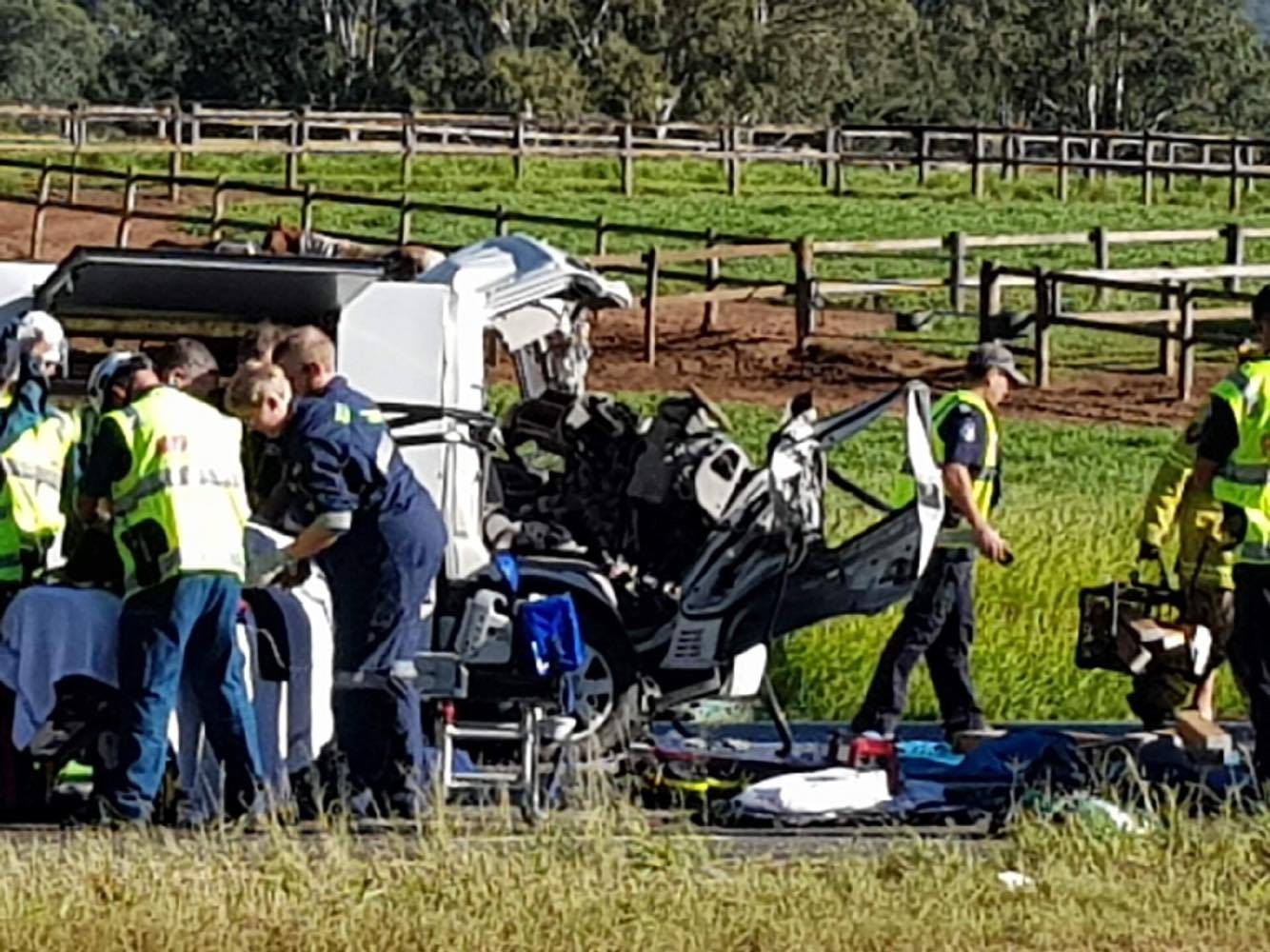 Emergency crews rush to free the woman pinned in her truck after this morning's horror crash.