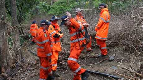 SES volunteers search a creek off Mt Glorious Rd for the teenager.