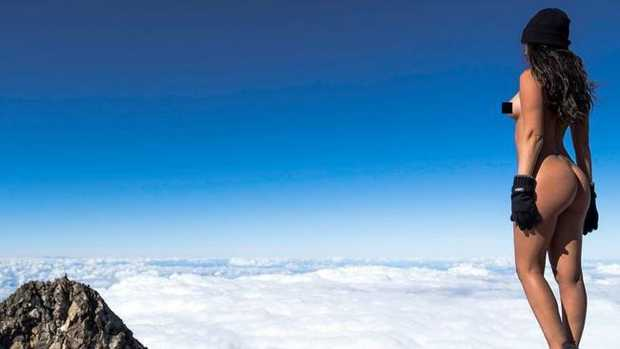 Playmate Jaylene Cook climbed Mt Taranaki, posing naked for images near the summit. Picture: Josh Shaw