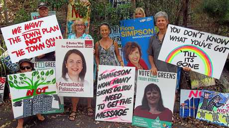 Protesters will recycle the signs donated by local state election candidates to protest about Sekisui's  proposed development at Yaroomba. Photo Contributed