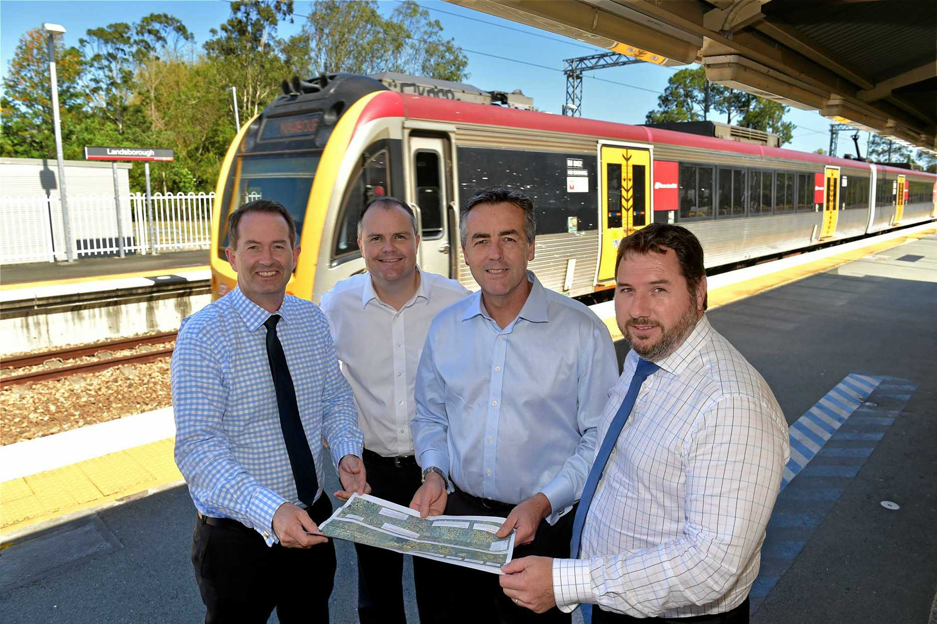 FEDERAL Infrastructure Minister Darren Chester at Landsborough Rail Station(second from right) with LNP members Andrew Wallace, Ted O'Brien (left) and Andrew Powell (far right).
