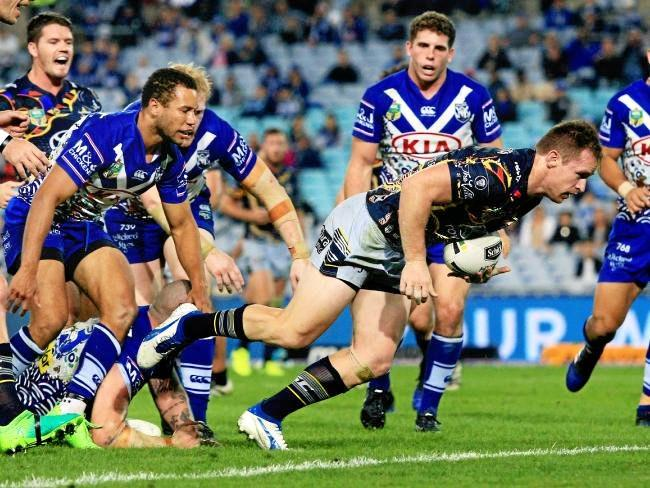Morgan scores a try for the Cowboys.