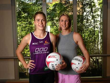 Clare McMeniman with young Firebirds player Kimberley Jenner.