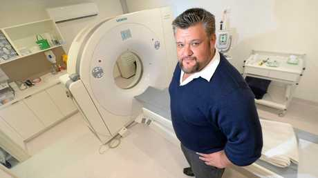 EVEN YEPPOON GOT ONE: CQMI Regional Manager Keri Kamau with their new CT Scanner at the Yeppoon Mater Hospital.